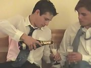 Newlyweds open their bottle of champagne in celebration of their wedding