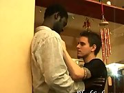 White gus unbuttons black guy's shirt and licks his chest