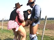 Brunette guy gets his mouth filled with two different cowboy boners