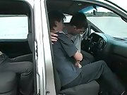 Two boys start making out and fooling around inside the van