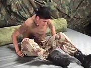 Young military boy stripping in a tent