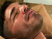 He's giving the bearded stud a hot blowjob