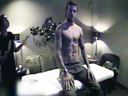 David Beckham takes off his shirt for a massage in a hidden camera video