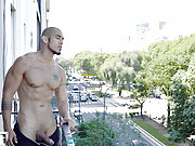 muscle-boy Louis Ricaute steps onto his balcony