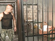 Muscle gay guard forced to fuck a young prisoner