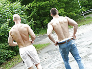 Muscle gay studs fuck bareback in a public place