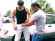 Yummy brunette dude rides a huge boner outside