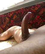 Hunk masturbating on the bed
